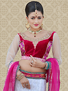 Take a look on the changing fashion of the season. This off white net a-line lehenga is nicely embroidered patch work is done with resham, zari and stone work. The beautiful embroidery on lehenga made it awesome and gives you stylish and attractive look to others. Contrasting red and pink choli and pink net dupatta is availble with this lehenga. Slight Color variations are possible due to differing screen and photograph resolutions.