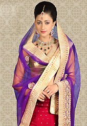 Outfit is a novel ways of getting yourself noticed. This red satin a-line lehenga is nicely embroidered patch work is done with resham, zari, sequins, stone and lace work. The beautiful embroidery on lehenga made it awesome and gives you stylish and attractive look to others. Contrasting fawn choli and purple net dupatta is availble with this lehenga. Slight Color variations are possible due to differing screen and photograph resolutions.