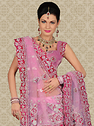No one like ordinary look, because every woman has their own beauty and our collection gives extra ordinary look to you. This pink net a-line lehenga is nicely embroidered and velvet patch work is done with zari, sequins, stone, beads and cutbeads work. The beautiful embroidery on lehenga made it awesome and gives you stylish and attractive look to others. Matching choli and dupatta is availble with this lehenga. Slight Color variations are possible due to differing screen and photograph resolutions.