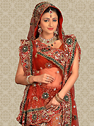 Be the cynosure of all eyes with this wonderful casual wear in flattering colors and combinations. This maroon net a-line lehenga is nicely embroidered and velvet patch work is done with zari, stone and cutbeads work. The beautiful embroidery on lehenga made it awesome and gives you stylish and attractive look to others. Matching choli and dupatta is availble with this lehenga. Slight Color variations are possible due to differing screen and photograph resolutions.