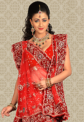 Elegance and innovation of designs crafted for you. This red net a-line lehenga is nicely embroidered patch work is done with zari, stone and cutbeads work. The beautiful embroidery on lehenga made it awesome and gives you stylish and attractive look to others. Matching choli and dupatta is availble with this lehenga. Slight Color variations are possible due to differing screen and photograph resolutions.