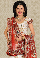Make your collection more attractive and charming with this impressive dress. This white net a-line lehenga is nicely embroidered and velvet patch work is done with stone and cutbeads work. The beautiful embroidery on lehenga made it awesome and gives you stylish and attractive look to others. Matching choli and red net dupatta is availble with this lehenga. Slight Color variations are possible due to differing screen and photograph resolutions.