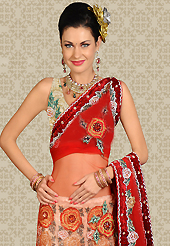 It's cool and has a very modern look to impress all. This cream net a-line lehenga is nicely embroidered and velvet patch work is done with resham, stone and cutbeadswork. The beautiful embroidery on lehenga made it awesome and gives you stylish and attractive look to others. Matching choli and red net dupatta is availble with this lehenga. Slight Color variations are possible due to differing screen and photograph resolutions.