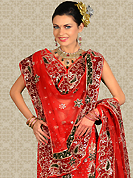 Take a look on the changing fashion of the season. This red net a-line lehenga is nicely embroidered and velvet patch work is done with zari, stone and cutbeads work. The beautiful embroidery on lehenga made it awesome and gives you stylish and attractive look to others. Matching choli and dupatta is availble with this lehenga. Slight Color variations are possible due to differing screen and photograph resolutions.