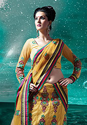 Stunning Seasnal colored the multi layered lehenga with floral embroidery is highlighted with a pleated yoke style part over the waist area.Slight color variason may be possible due to phoography
