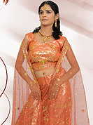 No one like ordinary look, because every woman has their own beauty and our collection gives extra ordinary look to you.  A Lehenga made with  Net Fabric.  This lehenga embellished with stone, sitara, zarkins, and resham work. The beautiful heavy embroidery made it awesome and gives you stylish and attractive look to others. The matching blouse and chunari are enhanced your personality.  Slight Color variations possible due to differing screen and photograph resolutions.
