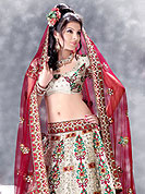 Make your collection more attractive  charming with this dazzling dress. A Lehenga made with Net fabric. This lehenga embellished with stone, sitara work, and beads. A beautiful embroiderey made it stylish and fabulous, gives you a stunning look. Slight Color variations possible due to differing screen and photograph resolutions.