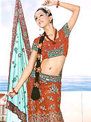 Lehenga in material with georgette maintain the artistic look as well as present look. This orange drape have floral patch pattern on lehenga done with stone, resham, zari and sitara. Mixing of green light blue color make this lehenga an ethnic look and increasing your beauty. Matching Blouse is available. Slight Color variations are possible due to differing screen and photograph resolutions.