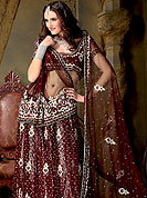 No one like ordinary look, because every woman has their own beauty and our collection gives extra ordinary look to you.  A Lehenga made with net Fabric is simply beautiful. This lehenga embellished with stone, sitara, zari, zarkins and resham work. The beautiful embroidery on lehenga made it awesome and gives you stylish and attractive look to others. The matching blouse and chunari are enhanced your personality.  Slight Color variations are possible due to differing screen and photograph resolutions.