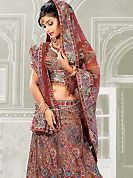 It's cool and has a very modern look to impress all. A Lehenga made with georgette fabric with net dupatta. This lehenga beautified with stone, sitara, zari, and resham worked rich embroidery. The beautiful border and embroidery made it awesome and gives you stylish and attractive look to others. The matching blouse and chunari are enhanced your personality. Slight Color variations are possible due to differing screen and photograph resolutions.