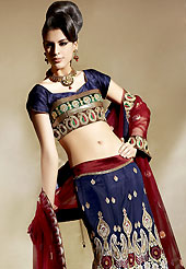 Embroidered lehengas are highly in order on a range of occasions such as wedding, formal party and festivals. This navy blue and maroon fish cut lehenga choli is nicely embroidered patch work. Embroidery is done with resham, zari and sequins work in form of floral and paisley motifs. The beautiful embroidery on lehenga made it awesome and gives you stylish and attractive look to others. Matching choli and contrast maroon dupatta is available with this lehenga. Accessories shown in the image is just for photography purpose. Slight Color variations are possible due to differing screen and photograph resolutions.