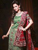 Get ready to sizzle all around you by sparkling lehenga. This green net A-Line lehenga choli is nicely embroidered work done with resham, zircon, nakshi, stone and cutdana work in form of floral motifs. Embroidery work on all over lehenga is stunning. Border on dupatta made it stylish and fabulous, gives you a stunning look. The beautiful embroidery on lehenga made it awesome and gives you stylish and attractive look to others. Mixing of color make this lehenga an ethnic look and increasing your beauty. Matching choli and contrast maroon net dupatta is availble with this lehenga. Slight Color variations are possible due to differing screen and photograph resolutions.