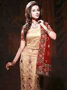 Take a look on the changing fashion of the season. This fawn net fishtail lehenga choli is nicely embroidered work done with resham, zircon, nakshi, stone and cutdana work in form of floral motifs. Embroidery work on all over lehenga is stunning. Border on dupatta made it stylish and fabulous, gives you a stunning look. The beautiful embroidery on lehenga made it awesome and gives you stylish and attractive look to others. Mixing of color make this lehenga an ethnic look and increasing your beauty. Matching choli and contrast maroon net dupatta is availble with this lehenga. Slight Color variations are possible due to differing screen and photograph resolutions.