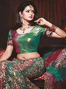 The traditional patterns used on this georgette lehenga maintain the ethnic look. This green and maroon net A-Line lehenga choli is nicely embroidered work done with resham, zari, nakshi, stone and cutdana work in form of floral motifs. Embroidery work on all over lehenga is stunning. Border on dupatta made it stylish and fabulous, gives you a stunning look. The beautiful embroidery on lehenga made it awesome and gives you stylish and attractive look to others. Mixing of color make this lehenga an ethnic look and increasing your beauty. Matching choli and dupatta is availble with this lehenga. Slight Color variations are possible due to differing screen and photograph resolutions.