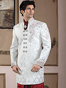 Make your collection more attractive with this dazzling sherwani. This sherwani made with pure banarasi fabric. This sherwani embellished with cutdana, pearls, beads and stones. Embroiderey work on collar, front and cuff made it stylish and fabulous, gives you a stunning look. Slight Color variations possible due to differing screen and photograph resolutions.