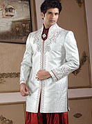 Its cool and have a very modern look to impress all. This sherwani made with pure banarasi fabric. This sherwani embellished with cutdana, beads, pearls and stones. The beautiful heavy embroidery on collar, front and cuff made it awesome and gives you stylish and attractive look to others. Slight Color variations possible due to differing screen and photograph resolutions.