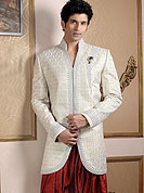 Today  fashion is really about sensuality which can be seen in this creation. Embellish yourself with the classy sherwani.  This sherwani made with pure Banarasi silk.  This sherwani embellished with stone, zardosi and stones  work. The beautiful heavy embroidery on collar made it awesome and gives you stylish and attractive look to others. Slight Color variations possible due to differing screen and photograph resolutions.