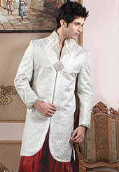 Fantastic sherwani made pure banarasi silk with dhoti. Amazing sherwani adorned with stones, zardosi and sequins. Stylish pazama made it very pretty. Outfit is a novel ways of getting yourself noticed. A heavy embroidery on front border, collar and cuffs are enhanced your personality. Slight Color variations possible due to differing screen and photograph resolutions.