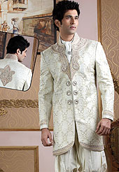 Emblem of fashion and style, each piece of our range of Designer Sherwani is certain to enhance your look as per todays trends baije jari jamewar fabric worked with stones, beads, pearls and cutdana. A contrasting dhoti are enhanced your personality. Outfit is a novel ways of getting yourself noticed. A heavy embroidery on front border, collar and cuffs are enhanced your personality. Slight Color variations possible due to differing screen and photograph resolutions.