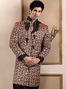 Make your collection more attractive with this dazzling sherwani. This sherwani made with banarasi fabric. This sherwani embellished with zardosi, pearls, beads and stones. Embroiderey work on collar, front and cuff made it stylish and fabulous, gives you a stunning look. Slight Color variations possible due to differing screen and photograph resolutions.