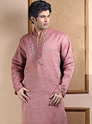 Its cool and have a very modern look to impress all. This kurta made with linen fabric. This kurta embellished with cutdana, beads, pearls and stones. The beautiful heavy embroidery on collar, front and cuff made it awesome and gives you stylish and attractive look to others. This kurta paired with same color fabric pathani salwar that completes the look. Slight Color variations possible due to differing screen and photograph resolutions.