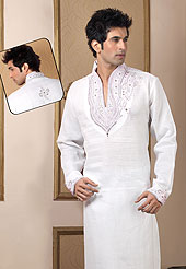 Make your collection more attractive with this dazzling dress. This kurta made with linen fabric. This kurta embellished with cutdana, beads, pearls and stones. The beautiful heavy embroidery on collar, front and cuff made it awesome and gives you stylish and attractive look to others. This kurta paired with same color fabric pathani salwar that completes the look. Slight Color variations possible due to differing screen and photograph resolutions.
