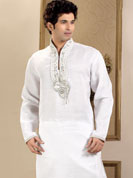 Today  fashion is really about sensuality which can be seen in this creation. Embellish yourself with the classy dress. This kurta made with linen fabric. This kurta embellished with cutdana, beads, pearls and stones. The beautiful heavy embroidery on collar, front and cuff made it awesome and gives you stylish and attractive look to others. This kurta paired with same color fabric pathani salwar that completes the look. Slight Color variations possible due to differing screen and photograph resolutions.