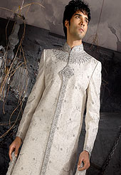 Make your collection more attractive with this dazzling sherwani. This sherwani made with brocade silk fabric. This sherwani embellished with sequins, stone, sitara work, and beads. Embroiderey work on collar, front and cuff made it stylish and fabulous, gives you a stunning look. Slight Color variations possible due to differing screen and photograph resolutions.