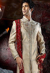 Today  fashion is really about sensuality which can be seen in this creation. Embellish yourself with the classy dress.  This sherwani made with Banarasi antique.  This sherwani embellished with stone,cutdana and zardosi work. The beautiful heavy embroidery on collar made it awesome and gives you stylish and attractive look to others. The contarsting churidar is enhanced your personality. Slight Color variations possible due to differing screen and photograph resolutions.