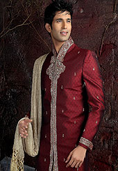 Its cool and have a very modern look to impress all. This sherwani made with pure silk fabric. This sherwani embellished with zardosi, beads, and stone work. The beautiful heavy embroidery on collar, front, back and cuff made it awesome and gives you stylish and attractive look to others. The matching readymade  dhoti with heavy look gives you traditional look. Slight Color variations possible due to differing screen and photograph resolutions.