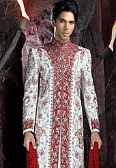 Its cool and have a very modern look to impress all. This sherwani made with art silk fabric. This sherwani embellished with beads, stone and  resham work. The beautiful heavy embroidery on collar, front, back and cuff made it awesome and gives you stylish and attractive look to others. The matching churidar is enhanced your personality. Slight Color variations possible due to differing screen and photograph resolutions.