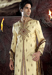 Make your collection more attractive with this dazzling sherwani. This sherwani made with brocade fabric. This sherwani embellished with beads, stone and  resham work. Embroiderey work on collar, front, back and cuff made it stylish and fabulous, gives you a stunning look. Slight Color variations possible due to differing screen and photograph resolutions.