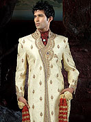 Its cool and have a very modern look to impress all. This sherwani made with brocade fabric. This sherwani embellished with stone, beads and  resham work. The beautiful heavy embroidery on collar, front, back and cuff made it awesome and gives you stylish and attractive look to others. The matching churidar is enhanced your personality. Slight Color variations possible due to differing screen and photograph resolutions.