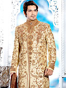 Emblem of fashion and style, each piece of our range of designer sherwani is certain to enhance your look as per todays trends. This cream sherwani embellished with zari, sequins, beads, stone and patch work. The beautiful heavy embroidery on front border, collar, back and cuffs made it awesome and gives you stylish and attractive look to others. Contrasting churidar is enhanced your personality. This sherwani made with cotton silk fabric. Accessories shown in the image is just for photography purpose. Slight Color variations are possible due to differing screen and photograph resolutions.