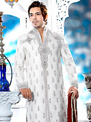 Its cool and have a very modern look to impress all. This off white sherwani embellished with all over self silver stone with resham, cutdana, beads and stone work. The beautiful heavy embroidery on front border, collar, back and cuffs made it awesome and gives you stylish and attractive look to others. Contrasting churidar is enhanced your personality. This sherwani made with jacquard fabric. Accessories shown in the image is just for photography purpose. Slight Color variations are possible due to differing screen and photograph resolutions.