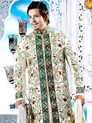 Make your collection more attractive with this dazzling dress. This cream sherwani embellished with green patch, fancy crystal, beads, sequins, stone and pitta work. The beautiful heavy embroidery on front border, collar, back and cuffs made it awesome and gives you stylish and attractive look to others. Contrasting churidar is enhanced your personality. This sherwani made with cotton silk fabric. Accessories shown in the image is just for photography purpose. Slight Color variations are possible due to differing screen and photograph resolutions.