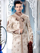 Today fashion is really about sensuality which can be seen in this creation. This light peach sherwani embellished with resham, zari, sequins, beads, cutdana, stone and patch work. The beautiful embroidery on front border, collar, back and cuffs made it awesome and gives you stylish and attractive look to others. Contrasting churidar is enhanced your personality. This sherwani made with cotton silk fabric. Accessories shown in the image is just for photography purpose. Slight Color variations are possible due to differing screen and photograph resolutions.