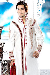 Its cool and have a very modern look to impress all. This off white sherwani embellished with resham, beads, sawroski diamond, zarkan , broches, stone and patch work. The beautiful heavy embroidery on front border, collar, back and cuffs made it awesome and gives you stylish and attractive look to others. Contrasting churidar is enhanced your personality. This sherwani made with jacquard fabric. Accessories shown in the image is just for photography purpose. Slight Color variations are possible due to differing screen and photograph resolutions.