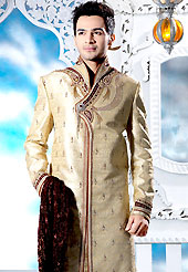 Today fashion is really about sensuality which can be seen in this creation. This beige sherwani embellished with zari, sequins, beads, cutdana, zarkan, stone and patch work. The beautiful heavy embroidery on front border, collar, back and cuffs made it awesome and gives you stylish and attractive look to others. Contrasting churidar is enhanced your personality. This sherwani made with jacquard fabric. Accessories shown in the image is just for photography purpose. Slight Color variations are possible due to differing screen and photograph resolutions.