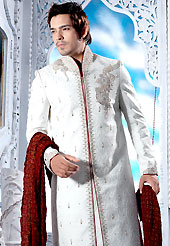 Make your collection more attractive with this dazzling sherwani. This off white sherwani embellished with sequins, beads, stone, zarkan, zardosi and patch work. The beautiful heavy embroidery on front border, collar, back and cuffs made it awesome and gives you stylish and attractive look to others. Contrasting churidar is enhanced your personality. This sherwani made with jacquard fabric. Accessories shown in the image is just for photography purpose. Slight Color variations are possible due to differing screen and photograph resolutions.