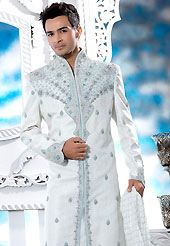 Its cool and have a very modern look to impress all. This off white sherwani embellished with resham, zari, sequins, cutdana, heavy stone and patch work. The beautiful heavy embroidery on front border, collar, back and cuffs made it awesome and gives you stylish and attractive look to others. Contrasting churidar is enhanced your personality. This sherwani made with jacquard fabric. Accessories shown in the image is just for photography purpose. Slight Color variations are possible due to differing screen and photograph resolutions.