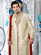 Today fashion is really about sensuality which can be seen in this creation. This cream sherwani embellished with sequins, beads,  zardosi, sawrovski, stone and patch work. The beautiful heavy embroidery on front border, collar, back and cuffs made it awesome and gives you stylish and attractive look to others. Contrasting churidar is enhanced your personality. This sherwani made with jacquard fabric. Accessories shown in the image is just for photography purpose. Slight Color variations are possible due to differing screen and photograph resolutions.