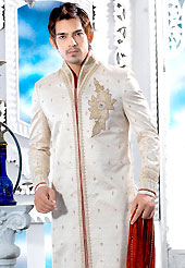 Make your collection more attractive with this dazzling dress. This off white sherwani embellished with all over cutdana, beads, zari, stone and patch work. The beautiful heavy embroidery on front border, collar, back and cuffs made it awesome and gives you stylish and attractive look to others. Contrasting churidar is enhanced your personality. This sherwani made with jacquard fabric. Accessories shown in the image is just for photography purpose. Slight Color variations are possible due to differing screen and photograph resolutions.