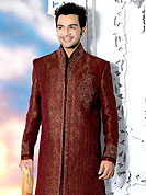 Today fashion is really about sensuality which can be seen in this creation. This maroon sherwani embellished with sequins, beads, stone, cutdana zardosi and patch work. The beautiful heavy embroidery on front border, collar, back and cuffs made it awesome and gives you stylish and attractive look to others. Contrasting churidar is enhanced your personality. This sherwani made with jacquard fabric. Accessories shown in the image is just for photography purpose. Slight Color variations are possible due to differing screen and photograph resolutions.