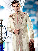 Its cool and have a very modern look to impress all. This cream royal look sherwani embellished with cut work, maroon velvet Patch, beads, sequins, all over heavy zarkan and stone work. The beautiful heavy embroidery on front border, collar, back and cuffs made it awesome and gives you stylish and attractive look to others. Contrasting churidar is enhanced your personality. This sherwani made with jacquard fabric. Accessories shown in the image is just for photography purpose. Slight Color variations are possible due to differing screen and photograph resolutions.