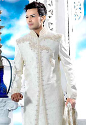 Emblem of fashion and style, each piece of our range of designer sherwani is certain to enhance your look as per todays trends. This off white royal look traditional sherwani designed with cutdana, pearl, beads, all over stone and patch work. The beautiful embroidery on front border, collar, back and cuffs made it awesome and gives you stylish and attractive look to others. Matching churidar is enhanced your personality. This sherwani made with brocade fabric. Accessories shown in the image is just for photography purpose. Slight Color variations are possible due to differing screen and photograph resolutions.