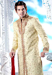 Today fashion is really about sensuality which can be seen in this creation. This cream sherwani designed with all over resham, beads, sequins, stone and patch work. The beautiful embroidery on front border, collar, back and cuffs made it awesome and gives you stylish and attractive look to others. Contrasting churidar is enhanced your personality. This sherwani made with cotton silk fabric. Accessories shown in the image is just for photography purpose. Slight Color variations are possible due to differing screen and photograph resolutions.