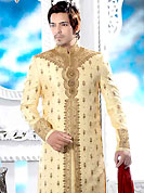 Make your collection more attractive with this dazzling dress. This cream elegant sherwani designed with all over resham, cutdana, beads, stone and patch work. The beautiful heavy embroidery on front border, collar, back and cuffs made it awesome and gives you stylish and attractive look to others. Contrasting churidar is enhanced your personality. This sherwani made with jacquard fabric. Accessories shown in the image is just for photography purpose. Slight Color variations are possible due to differing screen and photograph resolutions.