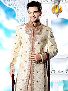 Its cool and have a very modern look to impress all. This cream sherwani designed with all over resham, beads, sequins, stone and patch work. The beautiful embroidery on front border, collar, back and cuffs made it awesome and gives you stylish and attractive look to others. Contrasting churidar is enhanced your personality. This sherwani made with cotton silk fabric. Accessories shown in the image is just for photography purpose. Slight Color variations are possible due to differing screen and photograph resolutions.