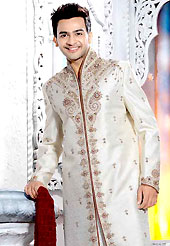 Make your collection more attractive with this dazzling dress. This off white elegant sherwani designed with all over stone, cutdana, beads, zarkan, broches, stone and patch work. The beautiful embroidery on front border, collar, back and cuffs made it awesome and gives you stylish and attractive look to others. Contrasting churidar is enhanced your personality. This sherwani made with brocade fabric. Accessories shown in the image is just for photography purpose. Slight Color variations are possible due to differing screen and photograph resolutions.